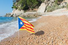 Catalan flag at beach Stock Photos