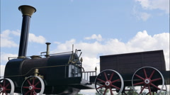 Old black locomotive. nostalgic background.sky with clouds, timelapse Stock Footage
