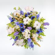 Floral arrangement made of artificial flowers on white background. Stock Photos