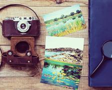 Film camera, magnifying glass, foto and photo album. - stock photo