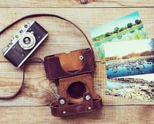 Very old film camera and old foto. - stock photo