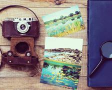 Film camera, magnifying glass, foto and photo album. Stock Photos