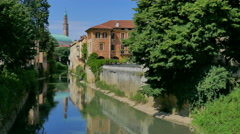 Vicenza - The Basilica Palladiana reflecting in the Retrone river - stock footage