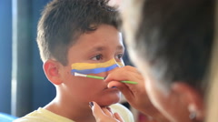 Face painting of a child 2 - stock footage