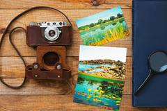 Film camera, magnifying glass, foto and photo album. - stock photo