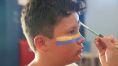 Face painting of a child 3 - stock footage