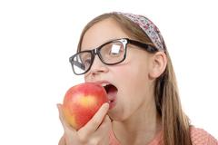 child girl eats a apple - stock photo