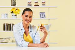 Attractive woman girl eating banana healthy food - stock photo