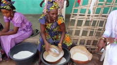 Africa native village woman sifting flour - stock footage