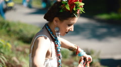 Young female model in mexican dress posing outdoor Stock Footage