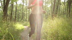 Athletic woman running on path Stock Footage