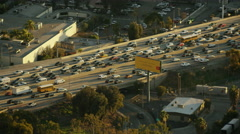 Aerial sunset view of elevated freeways city of Los Angeles California - stock footage