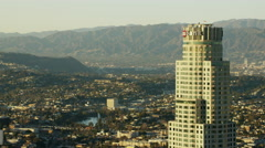 Aerial view at sunset of US Bank building downtown Los Angeles Stock Footage