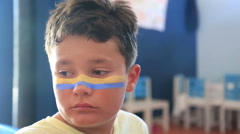 Face painting of a child - stock footage