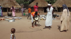 people preparing to kill animal to cook - Africa native village - stock footage