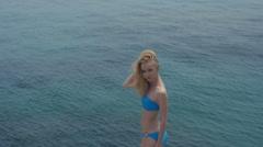 Beautiful slender blonde fashion model on sea. Summer travel photos Stock Footage
