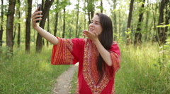 Woman in red shirt photographing themselve Stock Footage