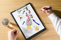 Concept of startup on a desk Kuvituskuvat