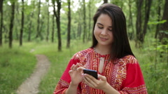 Woman holding a smartphone in the hands Stock Footage