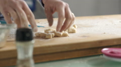 Housewife hands taking fresh gnocchi on the wood Stock Footage