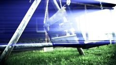 Old swing in the yard with light effect. weirdness Stock Footage