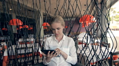 young beautiful blonde straight hair woman in the city sitting at the restaurant - stock footage