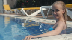 Portrait of the wet sexy young beautiful beauty blonde in pool Stock Footage