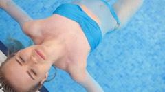 fashion sexy hot beautiful girl blonde model in swimwear lying near swimming - stock footage