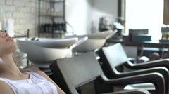 Woman getting her hair washed at the hairdresser Stock Footage