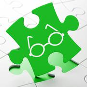 Learning concept: Glasses on puzzle background - stock illustration