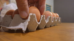 Sorting eggs in the egg tray Stock Footage