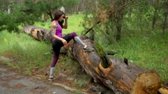 Sporty girl in the forest. Perform stretching. Look at the camera and smiling 4K Stock Footage