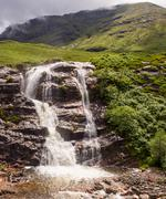 Glencoe waterfalls after heavy rainfall earlier, Glencoe, Highlands of Scotla - stock photo