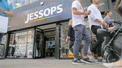 Oxford Street shoppers passing the Jessops photography store, London, UK Stock Footage