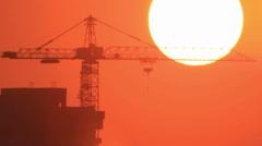 Build crane at sun on sky - stock footage