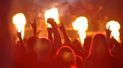 A huge crowd at a rock concert. Fans waving their hands. Slow motion. Stock Footage