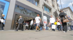 Oxford Street shoppers passing the Topshop fashion store, London, UK Stock Footage