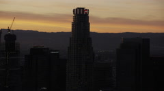 Aerial view sunset silhouette US Bank building Los Angeles Stock Footage