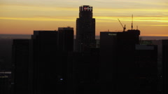 Aerial sunset silhouette of US Bank building downtown Los Angeles Stock Footage