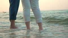 Barefoot man and woman on the beach Stock Footage