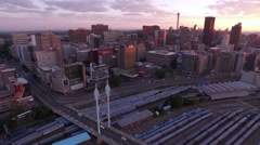 Aerial Shot Tracking backwards over of Nelson Mandela Bridge at sunrise - stock footage