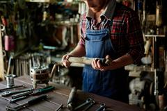 Repairman in workshop Stock Photos