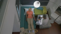 Timelapse of doctor visiting woman at home Stock Footage