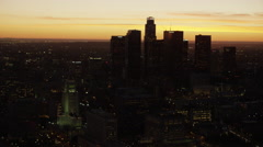 Aerial sunset silhouette view US Bank Los Angeles USA Stock Footage