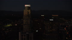Aerial night view of illuminated US Bank downtown Los Angeles Stock Footage