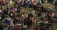 Community celebration crowd night park fast DCI 4K Stock Footage