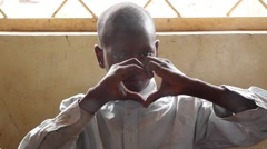 Africa native village school boy make heart with hands Stock Footage