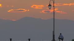 Man Fishing in Twilight Stock Footage