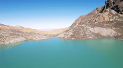 4K aerial view above glacier lake stream between mountains bolivia Stock Footage
