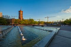Berlin's Rotes Rathaus and water cascades at Alexanderplatz Stock Photos